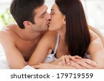 loving couple kissing in bed.... | Shutterstock . vector #179719559