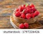 Raspberries In A Wooden Bowl On ...