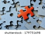 orange puzzle pice standing... | Shutterstock . vector #179751698