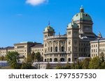 View of Federal Palace of Switzerland (Parliament Building) from south in old town of Swiss capital city Bern on sunny autumn day with blue sky and cloud, Switzerland
