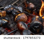 A Group With Chestnuts Getting...