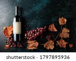 Bottle Of Red Wine With Ripe...