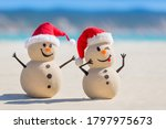 Two Sandy Christmas Snowmen Are ...
