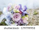 wedding bouquet and golden rings | Shutterstock . vector #179799953