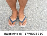 An Asian Man's Feet Are Wearing ...