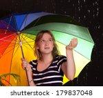 teenage girl sheltering from... | Shutterstock . vector #179837048