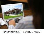Woman Choosing New House Online ...