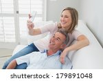 cheerful loving couple clicking ... | Shutterstock . vector #179891048
