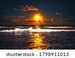 Full Moon Rising Over Sea Waves....