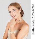 An attentive elegant pretty woman in a formal dress - stock photo