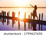 Girl Posing At Sunset On The...