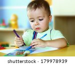 the boy draws a pencil at the... | Shutterstock . vector #179978939
