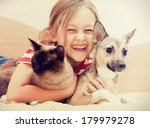 Stock photo child hugging a cat and dog 179979278