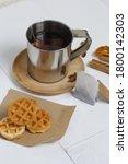 Mug Of Tea And Waffles. Nearby...