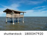 Wooden House In The Lagoon.the...