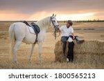 Man sitting on a straw bundle...