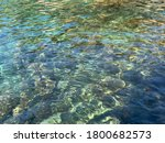 Beautiful crystal clear sea water. Ripple in the water. Want to dive. Aquatic paradise. Crystal clear Mediterranean sea. Ocean smooth surface. Amazing turquoise Adriatic sea. Blue marine. Light waves. - stock photo