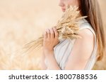 Girl Holding A Golden Ear Of...