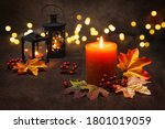 Lit Candles With  Autumn Leaves ...