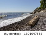 Seashore Of Flint Pebbles With...