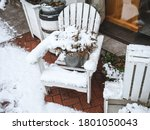A White Wooden Chair With A...