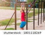 Girl Hanging On Horizontal Bar. ...