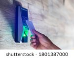 Small photo of Door access control. Staff holding a key card to lock and unlock door at home or condominium. Using electronic card key for access. Electronic key and finger scan access control system to unlock doors