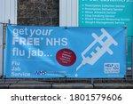 Small photo of Upholland, Lancashire, UK, 24/08/2020: Flu jab sign outside pharmacy