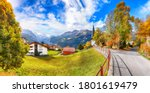 Astonishing autumn view of picturesque alpine village Wengen.  Sunny morning scene of Swiss Alps. Location: Wengen village, Berner Oberland, Switzerland, Europe. - stock photo