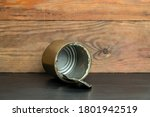 Tin Can On Wooden Background