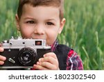 Little Cute Boy Photographer...