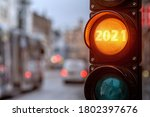 Small photo of A city crossing with a semaphore. Orange light with text 2020 in semaphore. Symbolic New Year approaching background concept