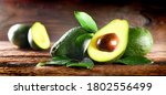 Avocado On Rustic Wooden Table. ...