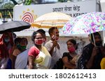 Small photo of Guwahati, India. 25 August 2020. People flout social distancing norms as they stand in a queue to register for Aadhar cards, amid the ongoing COVID-19 coronavirus pandemic, in Guwahati