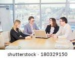 four businesspeople interacting ... | Shutterstock . vector #180329150