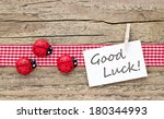 Ladybugs And Card On Wooden...
