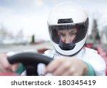 go cart driver looking at camera | Shutterstock . vector #180345419