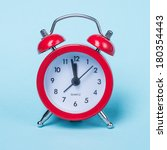 alarm clock on blue background | Shutterstock . vector #180354443