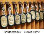 hotel room keys at reception... | Shutterstock . vector #180354590