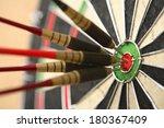 Five Darts Hitting Bullseye On...