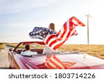 Woman Holding An American Flag...