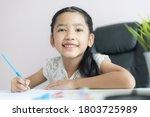 little asian girl using the...   Shutterstock . vector #1803725989