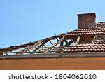 Damaged Roof With Fallen Tiles...