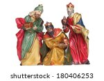 Small photo of Three wisemen nativity scene figures cutout, isolated on white background