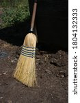 A Corn Silk Broom Resting On...