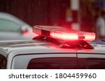 Flashing red lights or emergency lights located on the roof of a police car. - stock photo