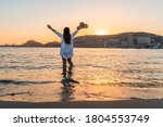 Woman Standing Inside The Sea...
