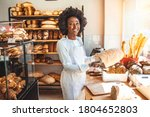 Smiling Baker Woman Standing...