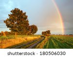 Rainbow Over Field Road At...