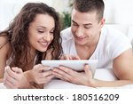 smiling young couple lying in... | Shutterstock . vector #180516209